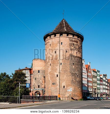 GDANSK POLAND - JULY 15 2014: Stagiewna Gate and tower in Gdansk, Poland. Old fortification built in 17th century