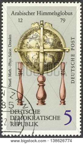 MOSCOW RUSSIA - CIRCA FEBRUARY 2016: a post stamp printed in DDR shows Arab Celestial Globe the series