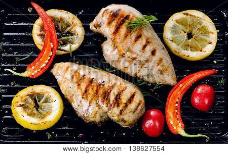 Two Grilled Chicken Breasts And Spices On A Grill Pan.