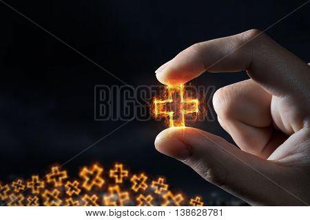 Cross symbol between fingers . Mixed media