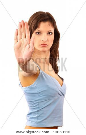 Portrait of a cute young female gesturing a stop sign isolated over white