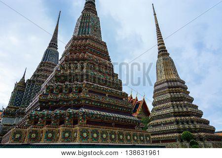 Bangkok, Thailand - June 30, 2016: Giant ornate chedis built for the burial of royal Thai kings at Wat Pho