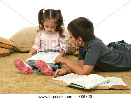 Brother And Sister Reading Books On The Floor
