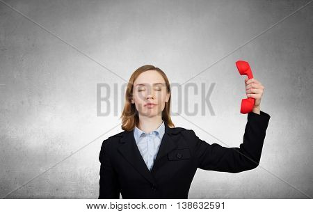 Woman holding red phone handset . Mixed media