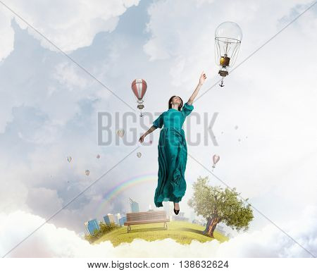 Woman floating in sky . Mixed media