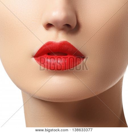 Close-up Of Woman's Lips With Bright Fashion Red Glossy Makeup