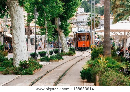 Port de Soller, Mallorca, Spain - May 26, 2016: Tram on the promenade of Puerto de Soller.