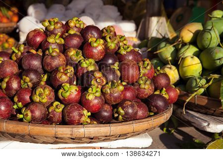 Basket with mangosteen at the street market, Vietnam