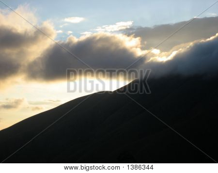Sunshine Through Clouds In Mountain