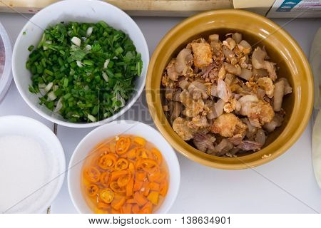 chopped green onion yellow pickled-chilli mix with vinegar and Pork crackling ingredient