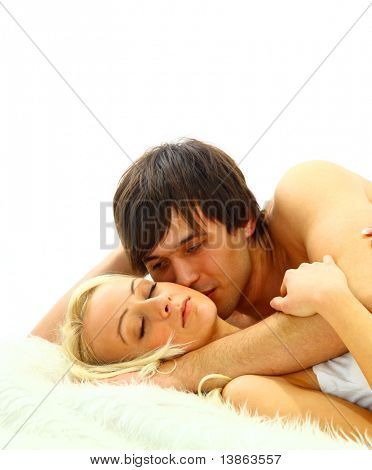 Intimate couple enjoying sexual intercourse on the bed