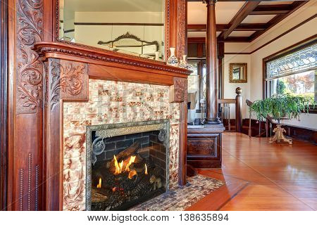 Clouse Up View Of Antique Fireplace With Decorative Tile Trim.