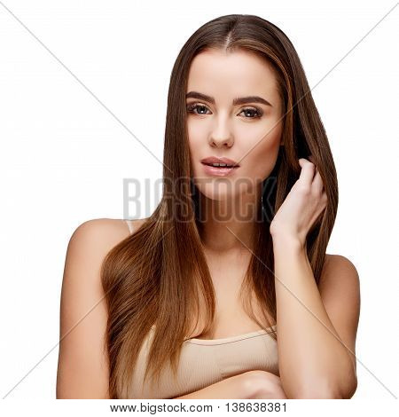 Beautiful Face of Young Woman with Clean Fresh Skin close up isolated on white. Beauty Portrait. Beautiful Spa Woman. Perfect Fresh Skin. Pure Beauty Model. Youth and Skin Care Concept