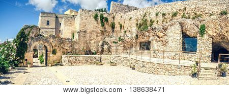 Foggia Italy 17 Agoust 2014 - Pulsano hermitage stone buildings complex entrance panoramic