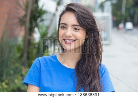 Beautiful caucasian woman with blue in city in the summer