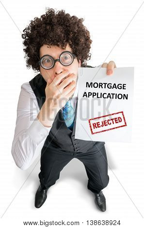 Disappointed Man Is Showing Document With Rejected Mortgage Appl