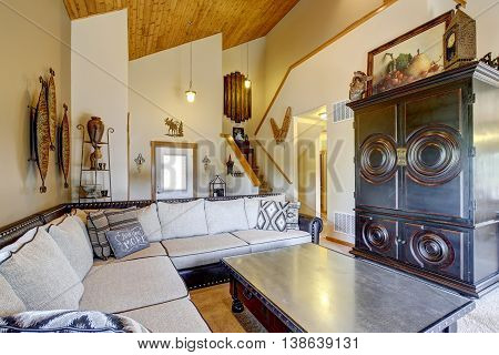 Cozy Living Room With High Wooden Vaulted Ceiling And Carpet Floor.