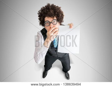 Top View On Disappointed Businessman Showing White Empty Paper F