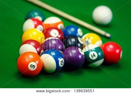 Billiard balls in a green pool table, game