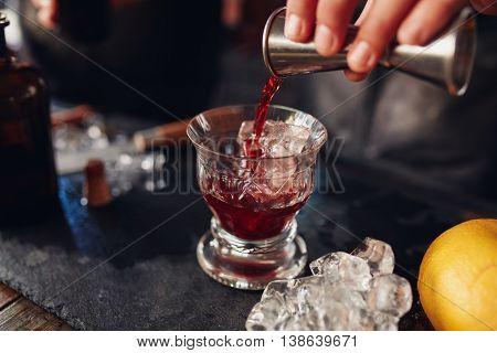 Barman Preparing Fresh Negroni Cocktail