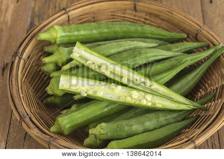 Okra Lady's Finger Bhindi and Bamies Vegetables and herbs in Basket.