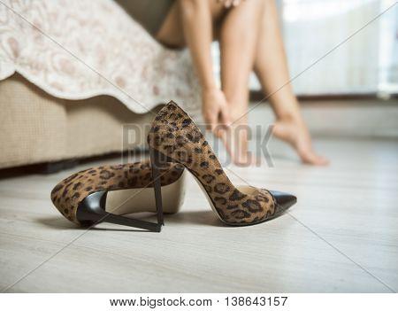 Woman with aching feet high quality studio shot