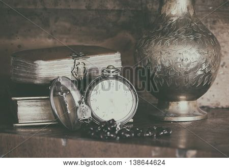 ancient bibles with pocket watch.
