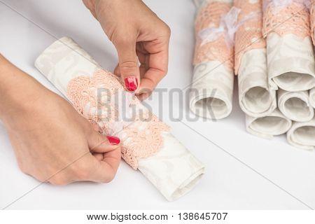 Woman adjusting vintage wedding napkins.