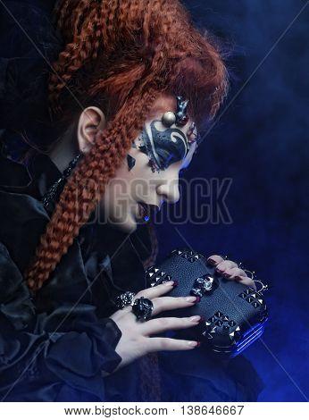 Dark redhair woman. Halloween picture.