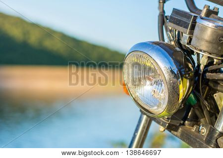 Motorbike by the lake close up. Summer exploration time
