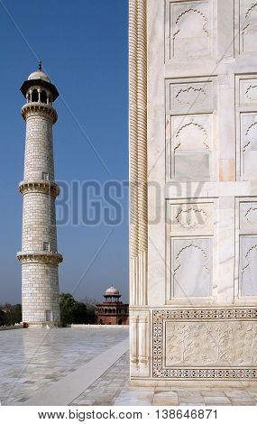 Agra, Uttar Pradesh, India - march 07, 2006: Taj Mahal, detail of one of the walls of the Mausoleum and one of the minarets