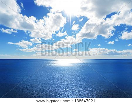 Sea scene with sparkling water and sun