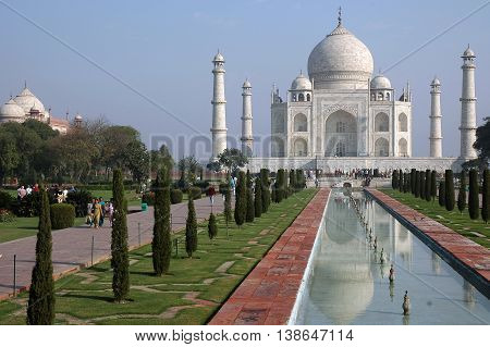 Agra, Uttar Pradesh, India - march 07, 2006: Taj Mahal seen from the gardens and pond, where the white marble building reflected