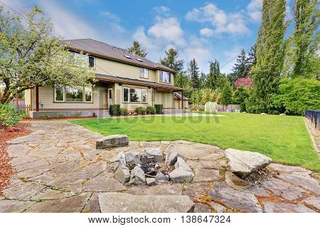 Exterior Of Luxury House With Grass Filled Back Yard