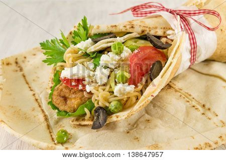 Tortilla Filled With Meat, Noodles And Vegetables.