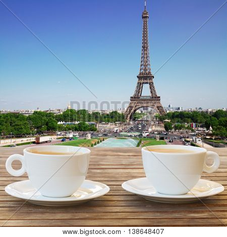 two cups of coffee in Paris with view of Eiffel Tower