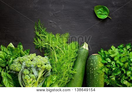 Green fresh vegetables on a black board organic farm or local farming or farm market concept space for a text