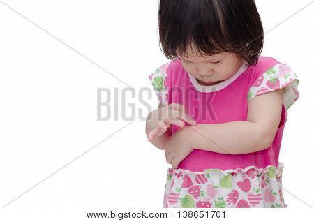 Little Asian girl scratching mosquito bite sore