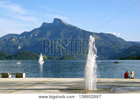 MONDSEE AUSTRIA - SEPTEMBER 22 2007: Outfitted Quay Mondsee lake with fountains in Austria