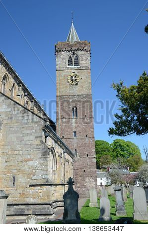 A view of the tower and graveyard at Dunblane cathedral