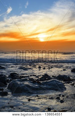 reflections at rocky beal beach near ballybunion on the wild atlantic way ireland with a beautiful yellow sunset