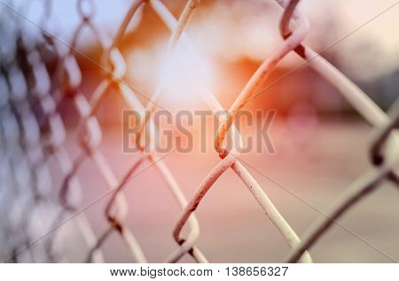 Rusty steel wire mesh fence under the sunlightsoft focus.