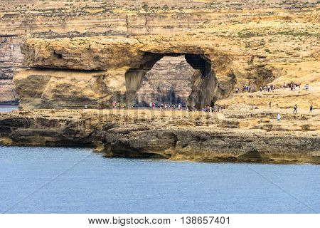 The Azure Window is Gozo's iconic flat-topped natural rock arch over the sea at Dwejra.