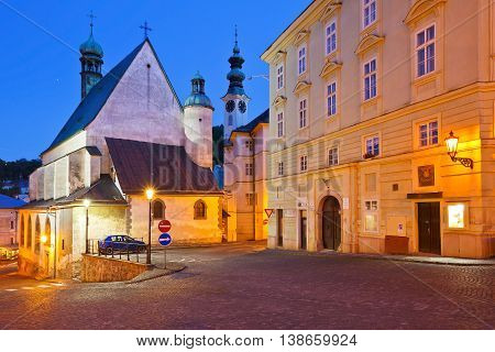 Town hall and a church in the old town of Banska Stiavnica, Slovakia.