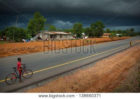 Yongoro Sierra Leone - June 02 2013: West Africa the village of Yongoro in front of Freetown rainstorm