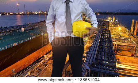 Construction worker concept . engineer  holding helmet and industry background