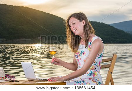 Woman Having A Video Call By The Lake