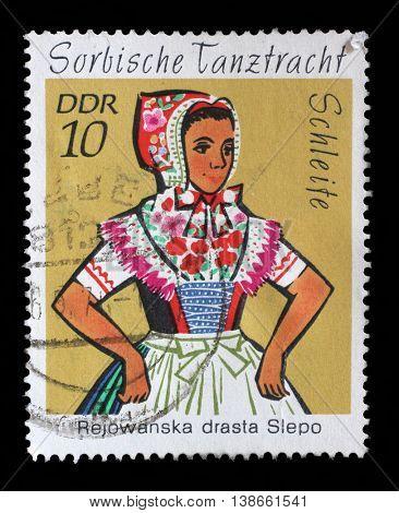 ZAGREB, CROATIA - JULY 03: a stamp printed in GDR shows Sorbian Dance Costume, Hoyerswerda, circa 1971, on July 03, 2014, Zagreb, Croatia