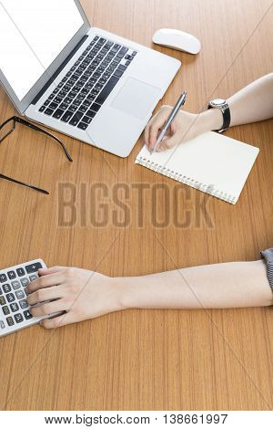 Businessman Working With Calculator And Computer Laptop On Office Desk