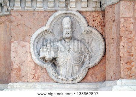 BOLOGNA, ITALY - JUNE 04: Saint Petronio by Giovanni di Riguzzo relief on facade of the San Petronio Basilica in Bologna, Italy, on June 04, 2015
